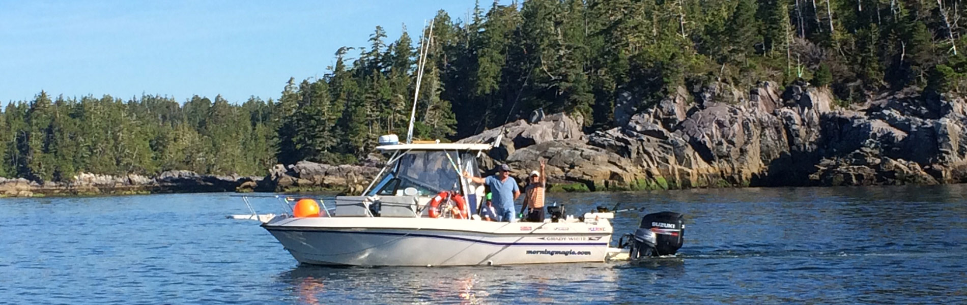 Fishing boat with 2 men in water near Ucluelet