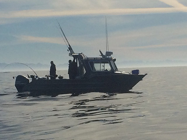 Salmon & halibut fishing charter boat in ocean
